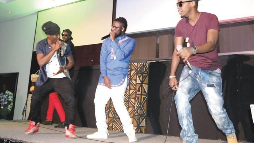 Grooving! Ugandan musician Ray Signature (in red shoes) performs with Two 4Real and Safi.