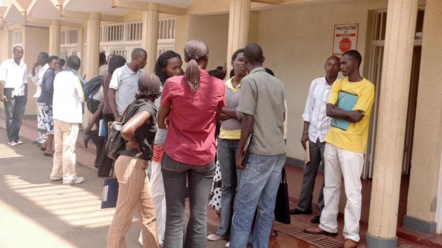 Students supported by FARG outside the Fund offices in Remera, Kigali. (File)