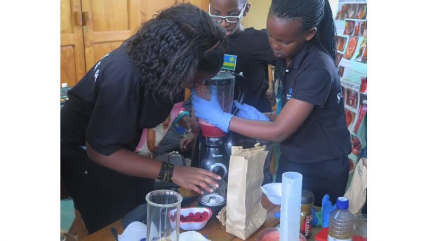 Pupils of Green HIlls Academy doing a practical during the Science Fair last week.  (Solomon Asaba)