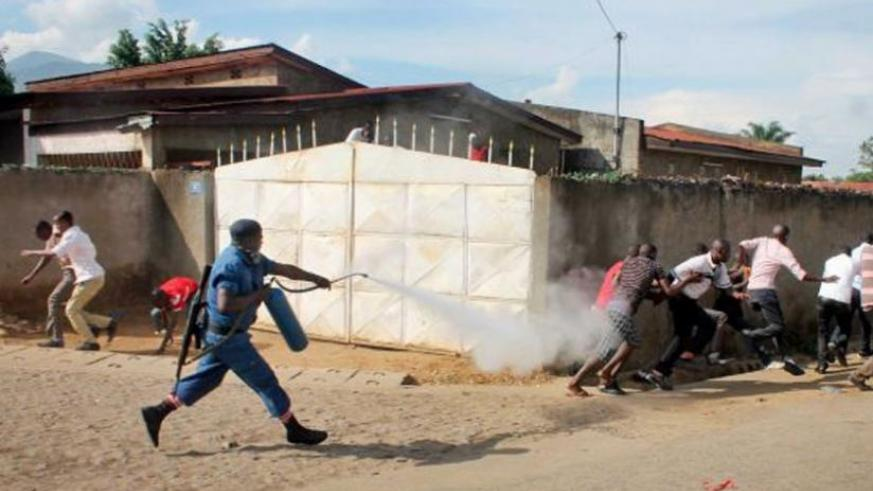A police officer fires tear gas at protesters in Bujumbura. (Net photo)