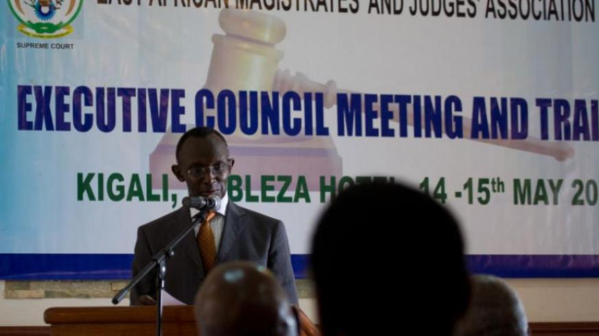 Chief Justice Prof Sam Rugege opening the meeting. (Timothy Kisambira)