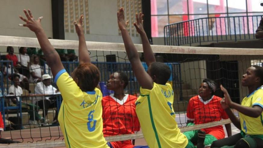 The National Sitting women volleyball team (yellow) play Kenya in a previous Zone 5 paravolleyball event in Nairobi. Rwanda wants to send both the men and women teams to paralympics. (Courtesy)