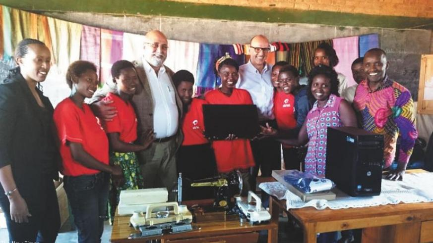 Bhullar(third left) and Soulet (fifth right) pose for a picture with the beneficiaries after handing over the equipment. (Courtesy photo)