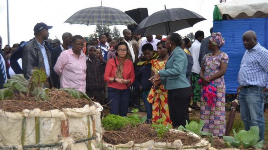 Farmers show Indrawati some of their activities during her visit to Nyabihu District, yesterday. (Jean d'Amour Mbonyinshuti)