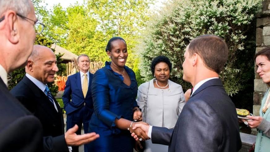 First Lady Jeannette Kagame is introduced to guests by Ansari (2nd L) as she arrives for the fundraiser. (Courtesy)