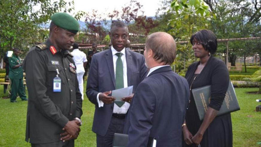 General Kabarebe chats with ambassador Shoham, Dr Anita Kiamba and Brig Gen Charles Karamba after the closure of the symposium. (Jean d'Amour Mbonyinshuti)