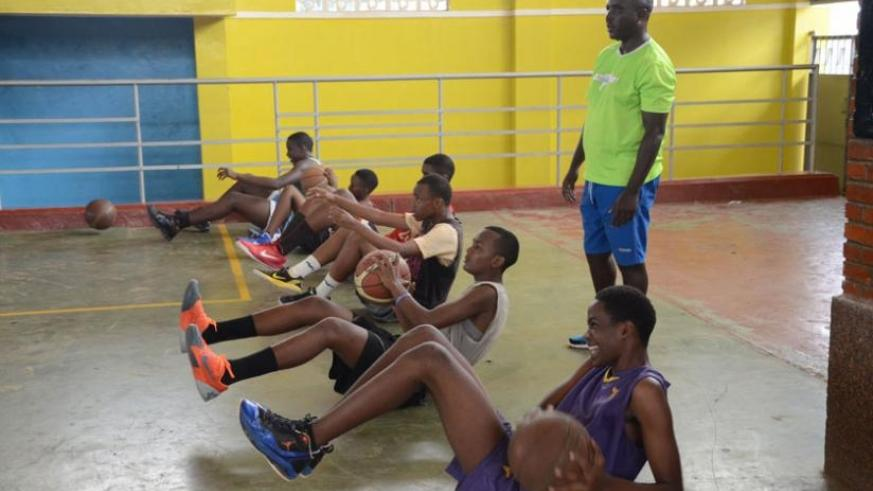 The U-16 boys team training at Amahoro stadium recently. Only Eritrea stand in their way to lift the 2015 Afro-Basketball tourney. (Sam Ngendahimana)