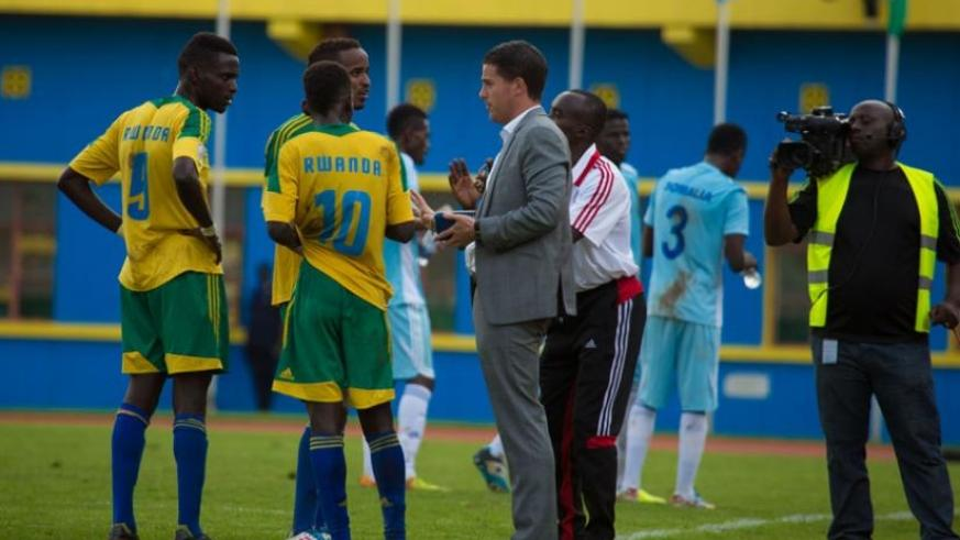 Amavubi and U-23 coach Johnny McKinstry gives instructions to his players during the Rwanda-Somalia match which the national side won 2-0. Mckinstry has called up more players as Rwanda prepares for a local derby against Uganda. (T. Kisambira)