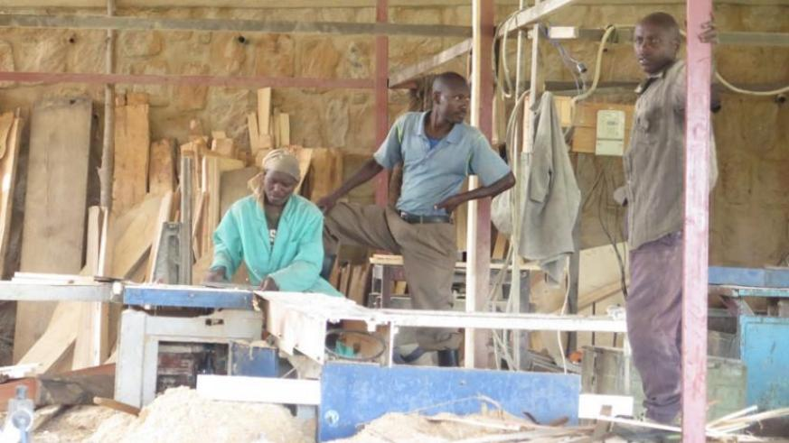 COOANYA members at work last week. The co-operative brings tother 30 individuals and firms involved in carpentry in Nyamagabe town. (Dennis Agaba)