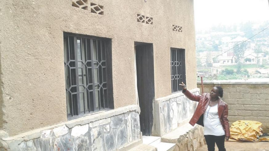Mukahirwa points at one of her houses which she rents out in Gishushu, Kigali. (File)