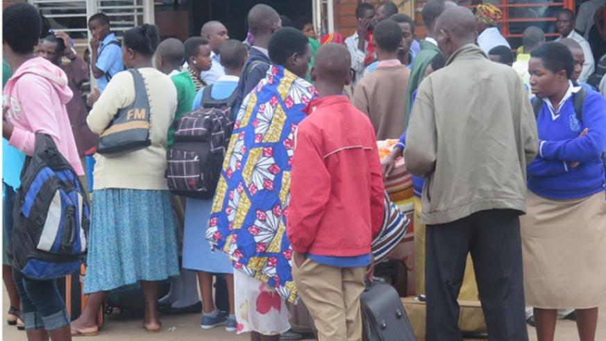 Learners wait for vehicles in Nyabugogo taxi Park at the start of last term.  Experts say parents should spend more time with their children if they are to impart certain values in them. (Solomon Asaba)