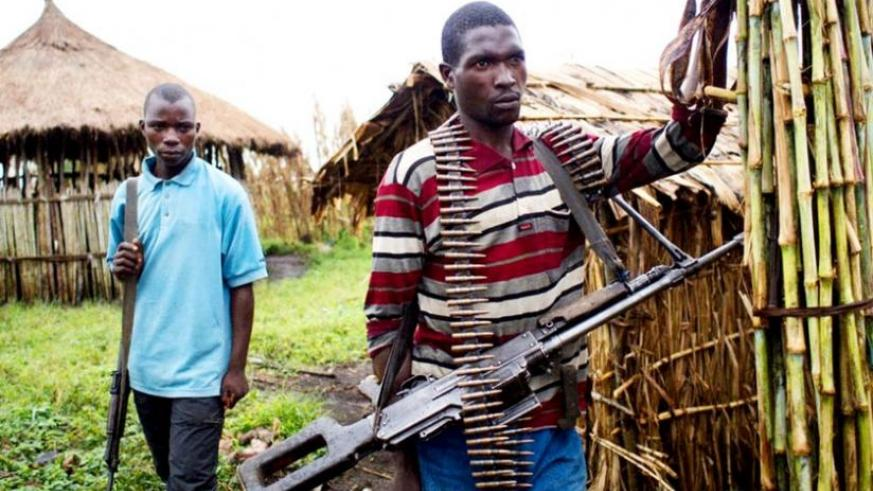FDLR militiamen at their camp in Buleusa in eastern DR Congo. (Net photo)