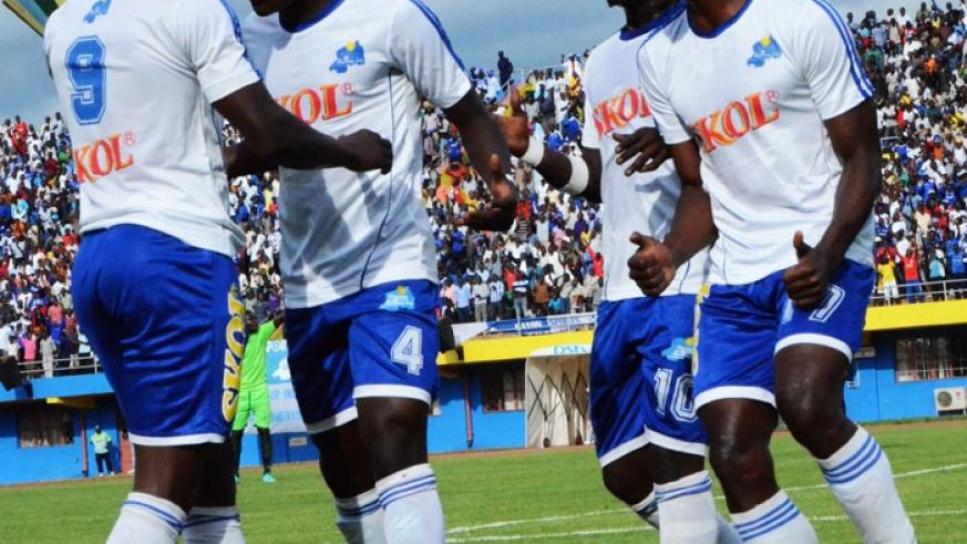 Rayon Sports striker Isaac Muganza (L) celebrates with team mates after scoring in a league game. The Blues  finished fifth after a turbulant season. (File)