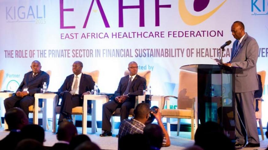 Dr Nyirinkwayaspeaks at the conference as Uganda's State minister for health, Dr Chris Baryomunsi (L),  Prime minister Anastase Murekezi (2nd left) and the State minister for Public Health and Primary Healthcare, Dr Patrick Ndimubanzi, at the meeting in Kigali on Tuesday. (T. Kisambira)
