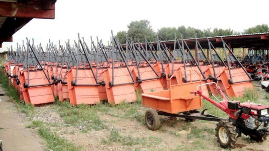 A power tiller (R) and several trailers at Minagri's Kabuye store in Kigali. (File)