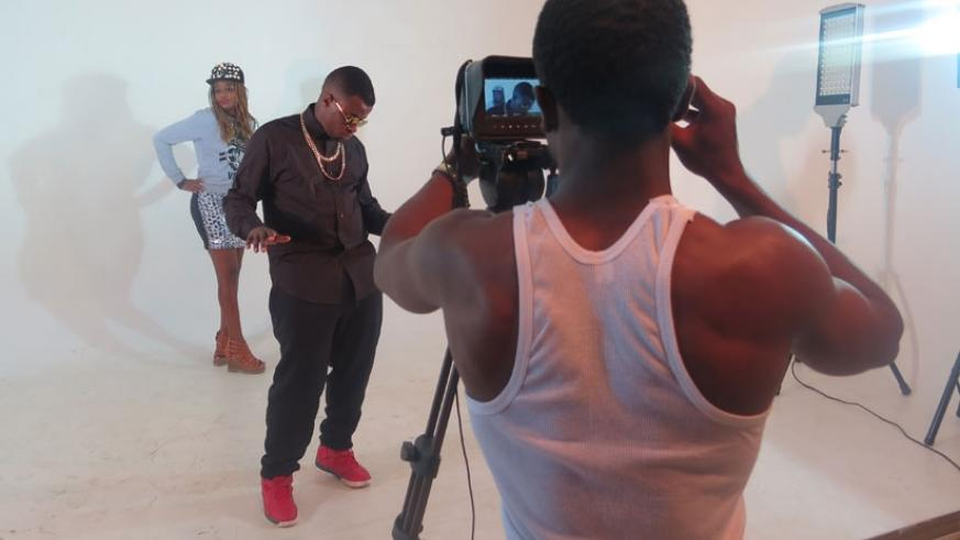 A local artiste shoots a music video inside the white room.