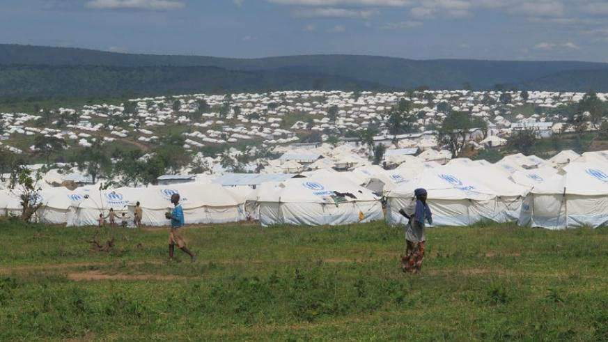 White tents that the refugees stay in.
