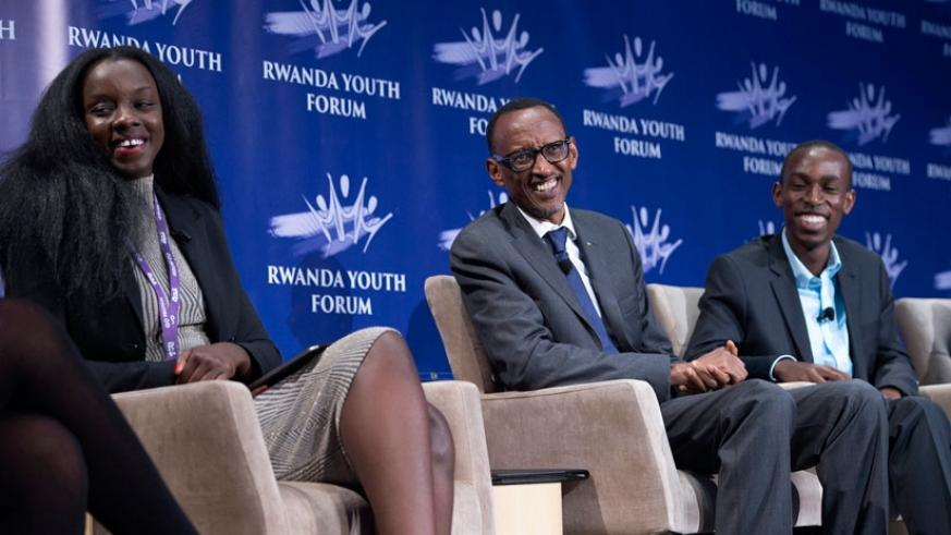 President Kagame shares a light moment with youth panelists Sandrine Irankunda (L) and Ephraim Rwamwenge at the Rwanda Youth Forum in Texas, US on Saturday. ( All photos by Village Urugwiro)