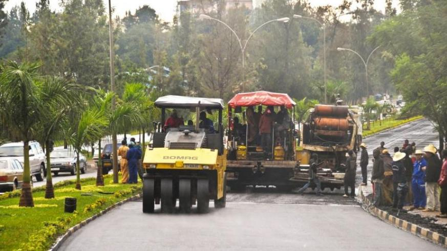 Contractors lay bitumen on Kigali International Airport road in 2009. (File)