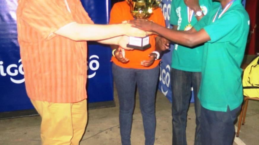 An IDebate official awards students from Liquidnet (Agohozo Shalom) in Kigali on Saturday. (S. Asaba)