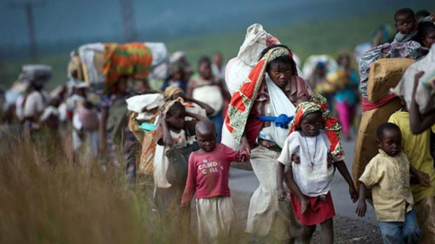 Congolese flee their homes in the past. FDLR is one of a myriad of militia groups that continue to prey on Congolese civilians, repeatedly driving thousands out of their homes. (Net photo)
