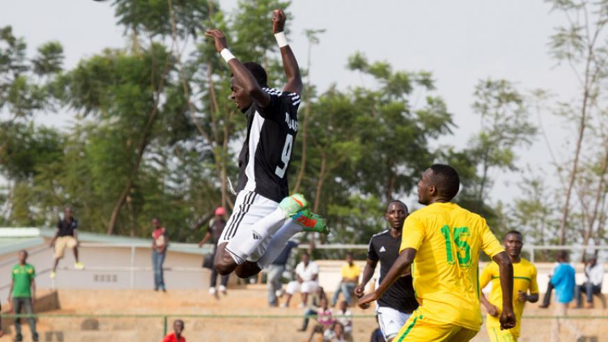 APR's Bernabe Mubumbyi jumps to head the ball away against AS Kigali earlier this season. (File photo)