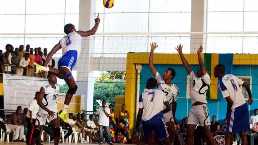 INATEK's Christophe Mukunzi (4) attempts to score against APR in last year's Genocide Memorial Tournament at Petit Stade. (File)