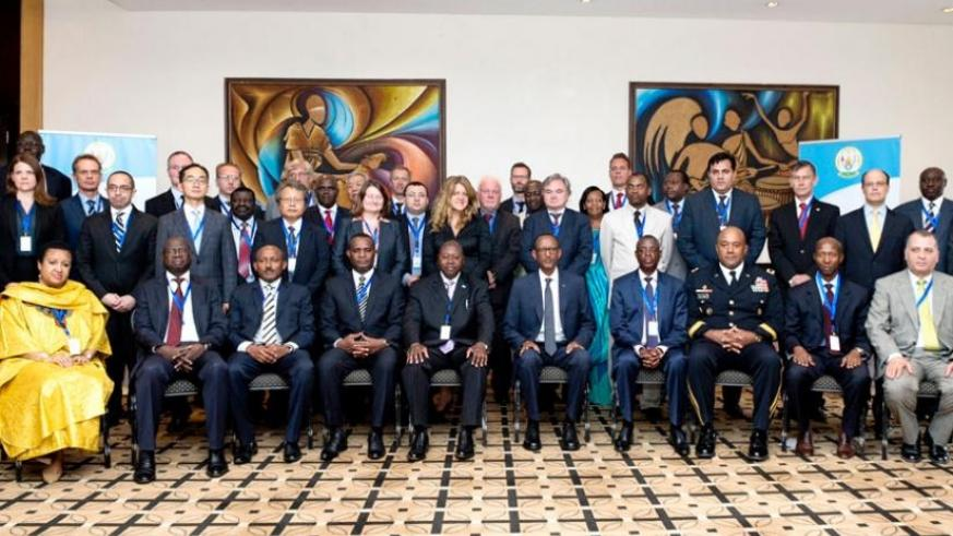 President Kagame in a group photo with participants of the International Conference on Civilian Protection in Kigali yesterday. (Village Urugwiro)