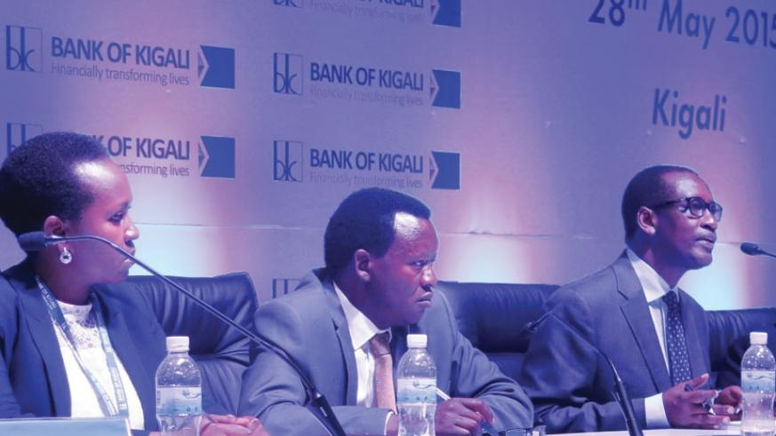 Bank of Kigali CEO James Gatera (right) speaks at the media briefing on Thursday as Shivon Byamukama, BK secretary and head of corporate affairs, and Daniel Ufitikirezi, a board member, look on. (Solomon Asaba)