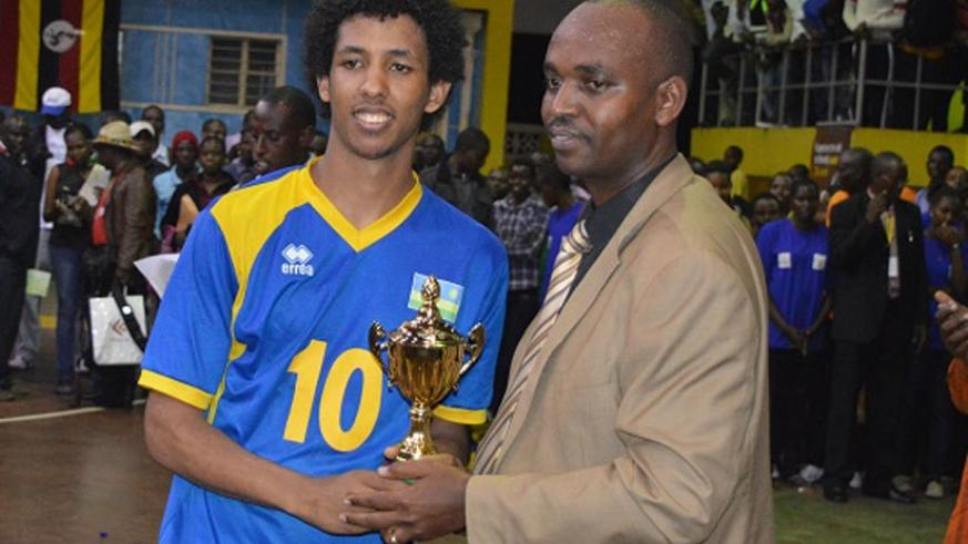 Ivan Mahoro receives the trophy for Best setter at this year's Zone V Championships. (File)