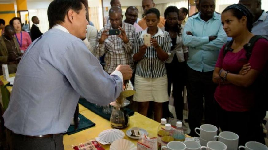 Jose Kawashima shows participants how to brew a variety of coffee from around the globe. (Doreen Umutesi)