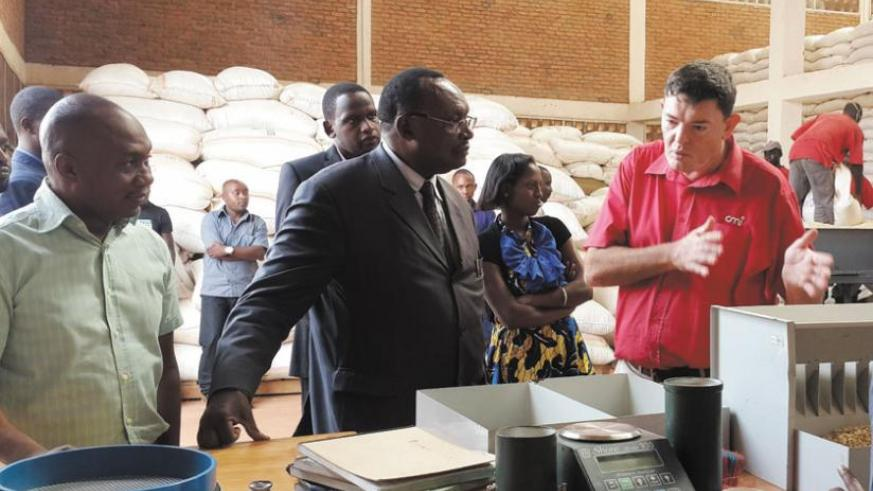 Merwe (right) explains how they test the quality and grade farmers' grains at the an EAX warehouse as Minister for Trade and Industry, Francois Kanimba and EAX chief Kadri look on during a tour of the facility this week. (Courtesy)