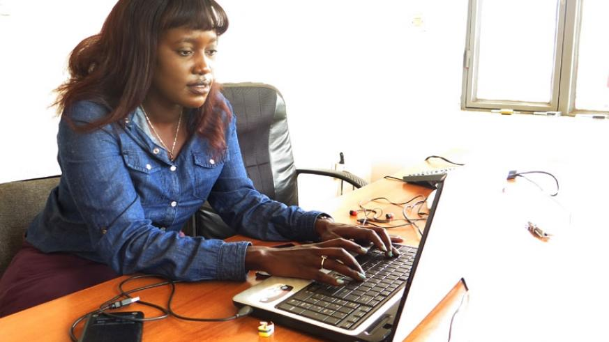 Nyebaza at work. The young business woman has rose through the ranks to become the second vice-president of local clearing and forwarding association. (Ivan Ngoboka)