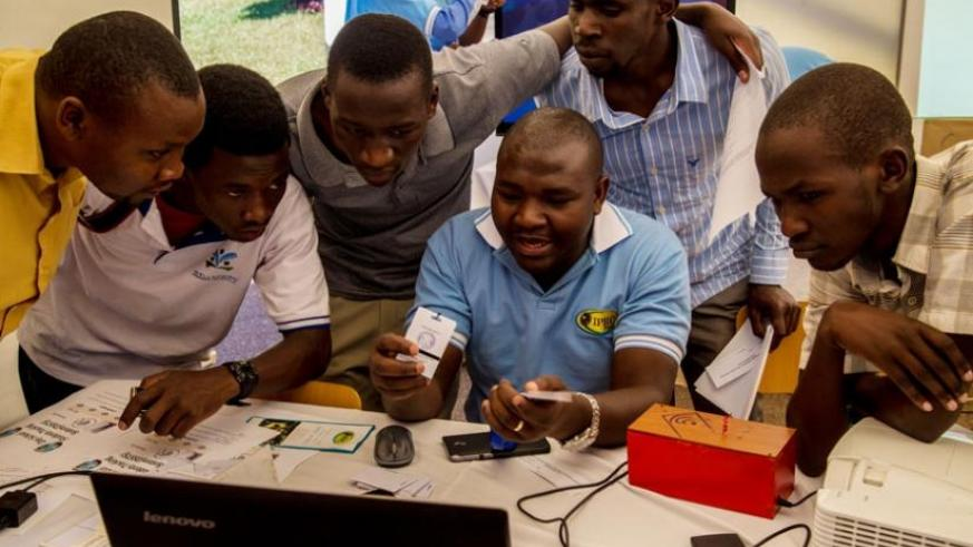 Students of the University of Rwanda's College of Science and Technology view a system of tracking day scholers during the Kigali Innovation fair for education yesterday. (Doreen Umutesi)