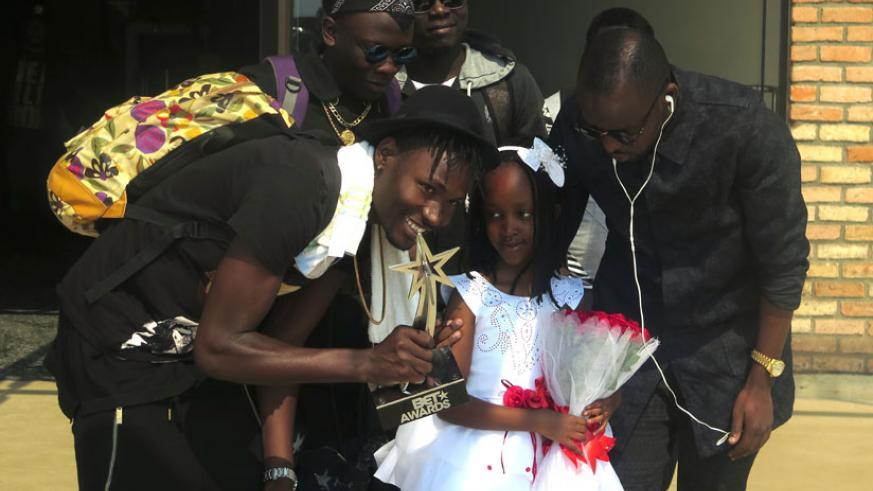 Kenzo and his crew are welcomed by a young girl at the airport. (Stephen Kalimba)