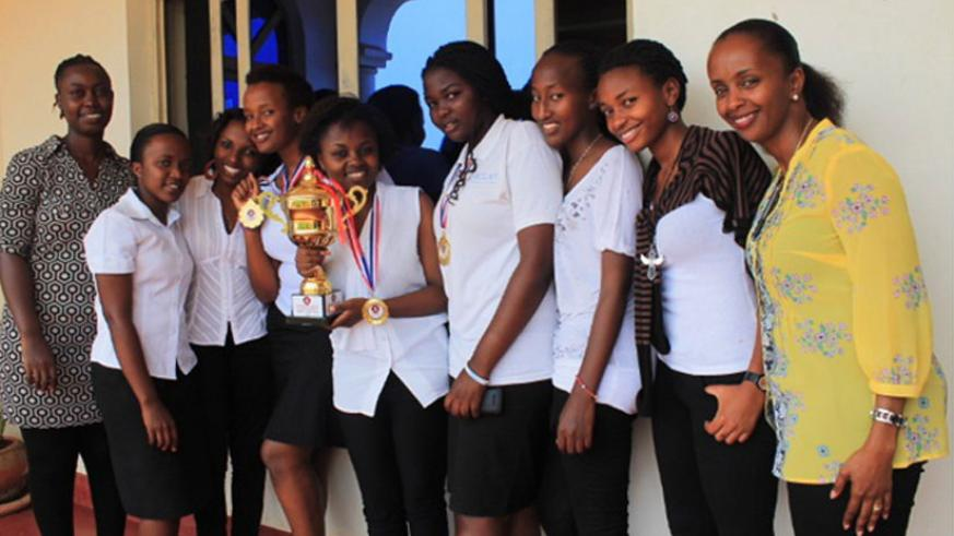Akilah debate club members in a photo with the Country Director (extreme right) and the Debate club coordinator. The club won the 2015 inter-university debate in Kigali in June. (Courtesy)