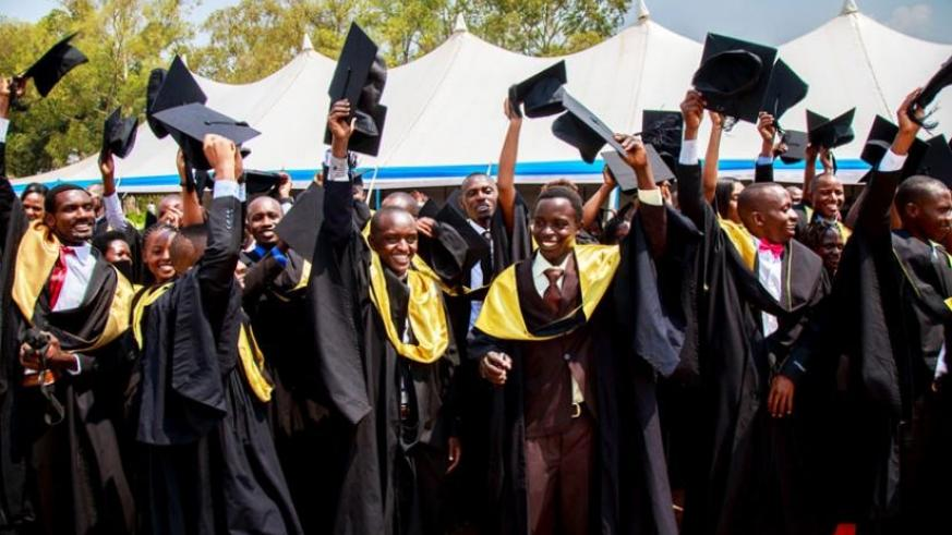 Graduates celebrate after being conferred upon with degrees at University of Rwanda last          week. (File)