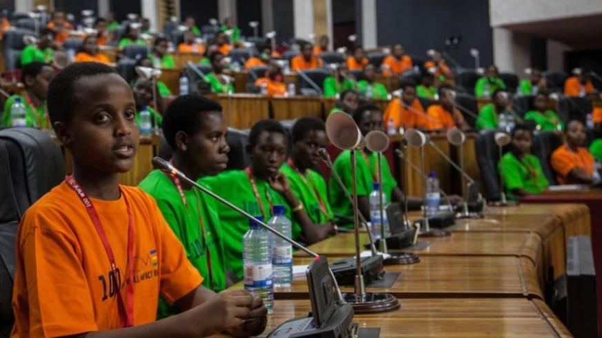 Participants in the plenary chamber learn about the role of Members of Parliament. (Faustin Niyigena)