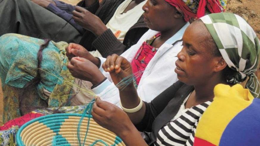 Ruhango District's Berwa Women's group members weave baskets. Such small projects have helped millions of rural poor to improve their livelihoods. (File)