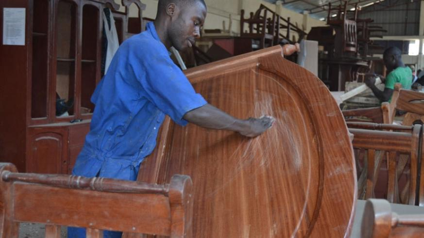 Bizimana makes a bed at his workshop in Rubavu District on Wednesday. (All photos by Jean d'Amour Mbonyinshuti)