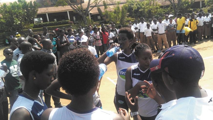 GS Indangaburezi players listening to a brifying during a time-out yesterday. (Richard Bishumba)