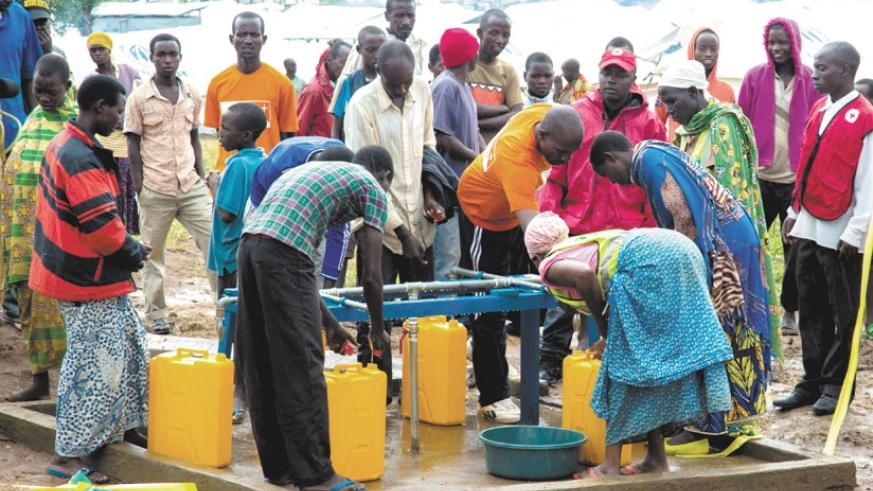 Burundian refugees at Mahama camp fetching water. More refugees continue to pour in, as some reports suggest that some Rwandans have been held illegally by Burundian authorities in unclear circumstances. (File)