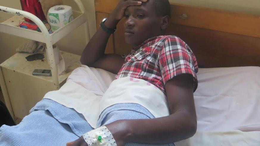 Agaba lies on his hospital. He is still recovering after undergoing an operation recently. (Solomon Asaba)