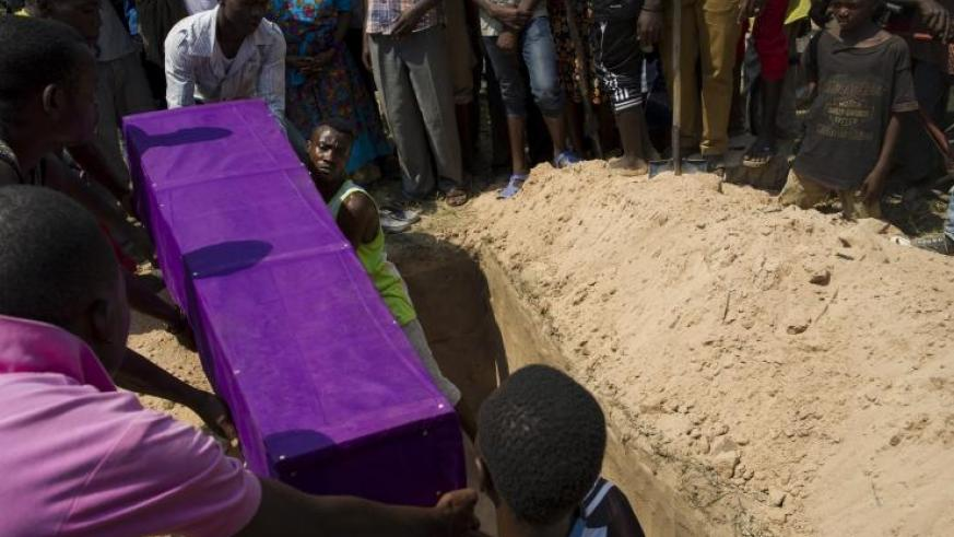 Men bury the coffin of Emmanuel Ndere Yimana, an opposition supporter who was assassinated, during his funeral in Burundi's capital city of Bujumbura July 23, 2015. Burundian opposition activist Pontein Barutwanayo reportedly was gunned down at a bar near Bujumbura. (Getty Images)