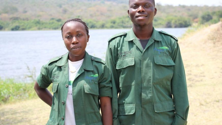 Nishimwe (right)  with a fellow community freelance guide. The duo is part of a larger group that has helped ease pressure of demand for guides at Akagera.  (Photos: Sarine Arslanian)