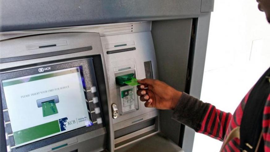 A client withdraws money from an ATM. Financial accounts' ownership among Rwanda's adult population of 7 million people stands at 77 per cent, according to the scorecard. (Timothy Kisambira)