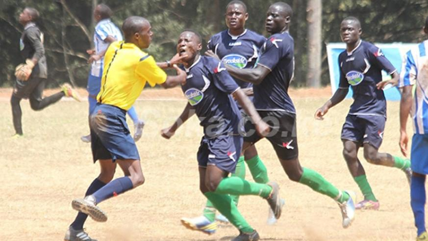 Kitende players attack match referee Francois Ngarambe on Saturday. (Courtesy)