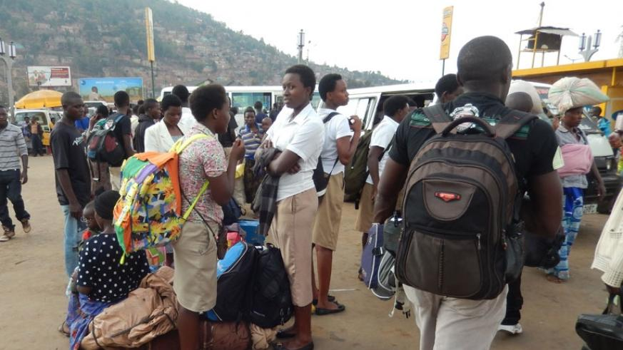 Students wait for a taxi in Nyabugogo park to return to school. Some students are sent back home as soon as they report to school over fees.  (Solomon Asaba)