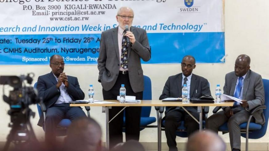 Prof James McWha, the vice-chancellor of the University of Rwanda (C), speaks at the forum on research and innovation in Kigali yesterday. (Timothy Kisambira)