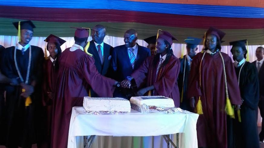 Kabonero (centre) and Onyango (second left) share a light moment with the graduands on Saturday. (Shamim Nire)
